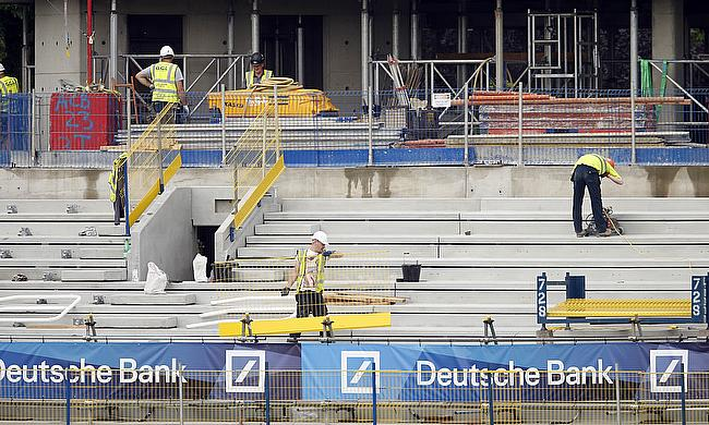 Builders work on the Warner Stand redevelopment