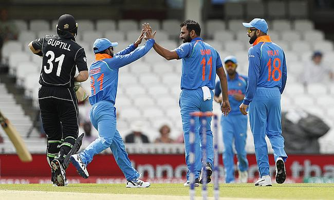 Indian players celebrating the wicket of Martin Guptill (left) in the warm-up game