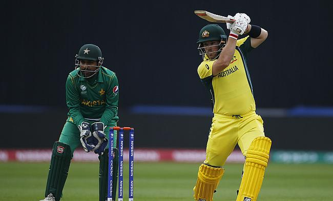 Aaron Finch (right) looked solid before the rain arrived