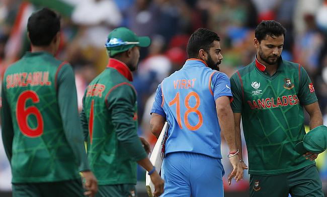 Mashrafe Mortaza (right) reacts after the defeat to Bangladesh