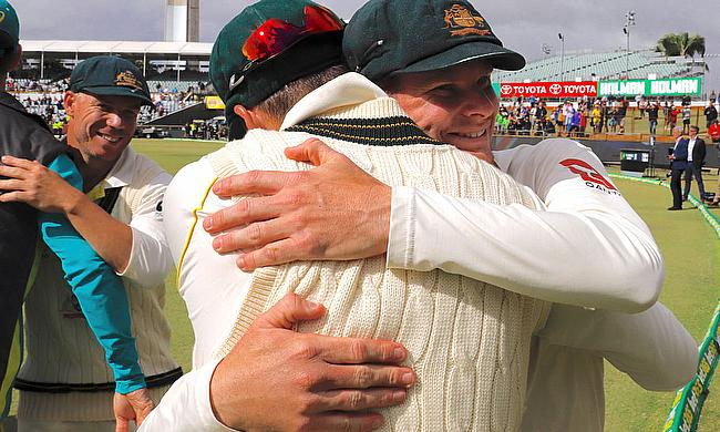 Australia's captain Steve Smith hugs team mates