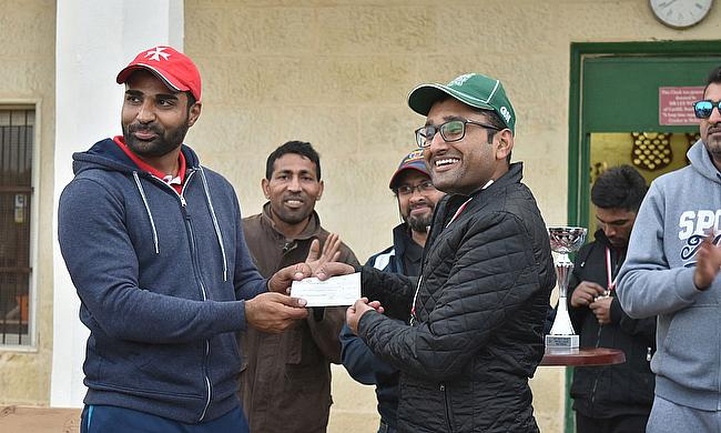 Victorious captain - Haroon Mughal collects the Winners Cheque for Boom Boom 7