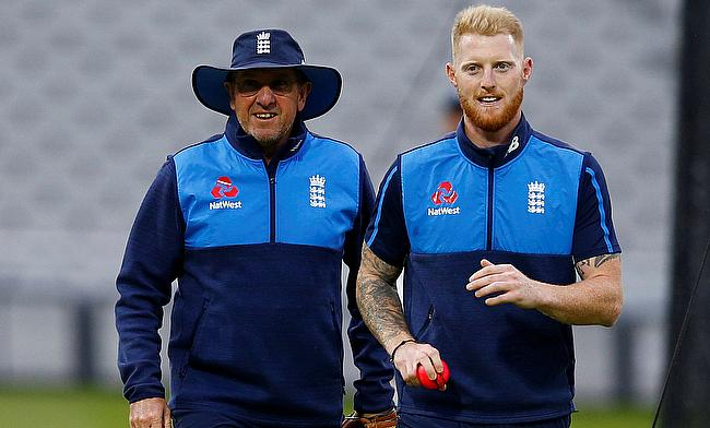 Trevor Bayliss (left) insists Ben Stokes need to force his way back into the team