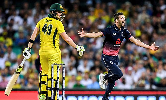 England's Mark Wood celebrates after dismissing Australia's Steve Smith during the one-day international match at the Sydney Cricket Ground