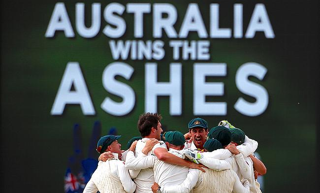 Australian players celebrate after winning the third Ashes Test in Perth