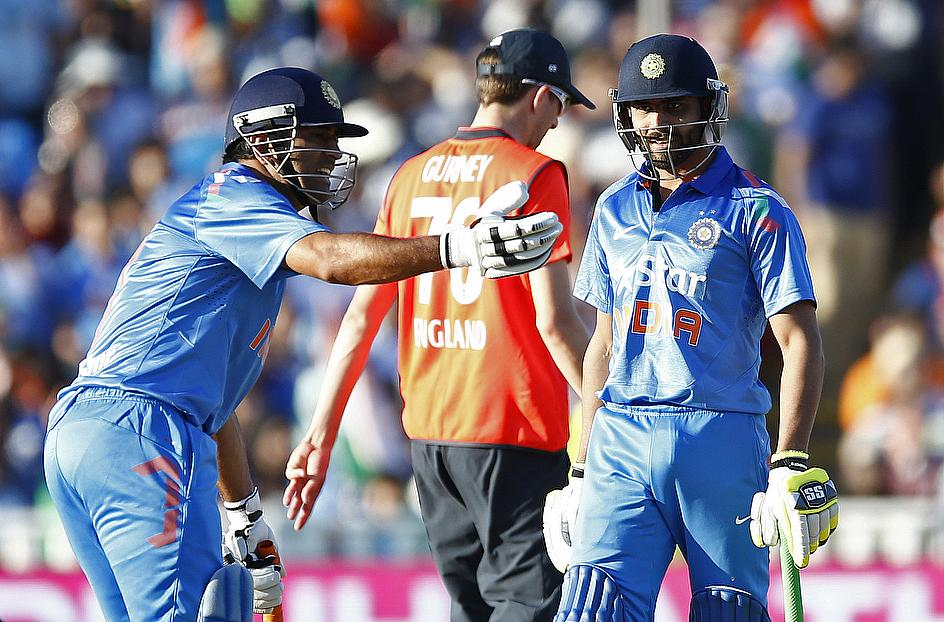 MS Dhoni (left) gesticulates after Ravindra Jadeja was run out