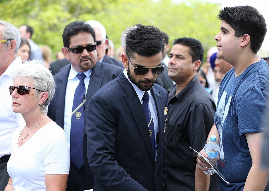 Image result for virat kohli Attending Phil Hughes' Funeral