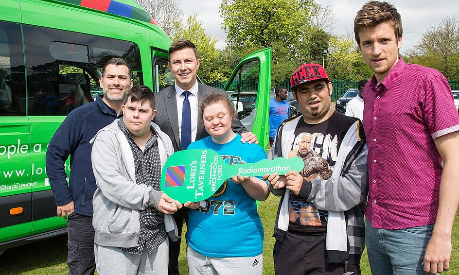 Greg James (right) presents youngsters in Enfield with the brand new Lord's Taverners minibus