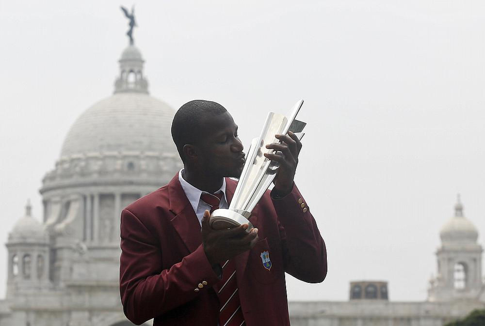 Darren Sammy poses with the ICC WT20 trophy