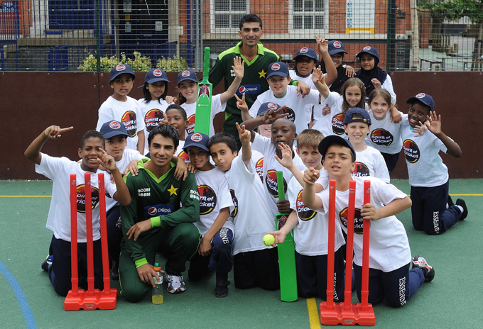 Salman Butt and Yasir Hameed with children at the event