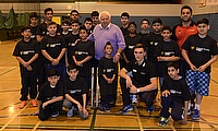 Farokh Engineer (centre, lilac shirt) and Gavin Griffiths (back row, far right) joined youngsters in Manchester to play street cricket