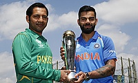 Sarfraz Ahmed (left) and Virat Kohli with the Champions Trophy before the final