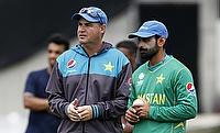 Mohammad Hafeez (right) faces another uphill task to prove his bowling action right
