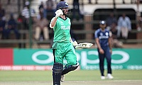 Andrew Balbirnie celebrating his century against Scotland