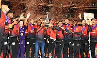 Trinbago Knight Riders lift the winners trophy