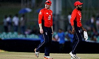 England's captain Eoin Morgan (L) and Adil Rashi