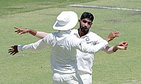 Jasprit Bumrah (R) celebrates with a teammate