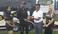 Samuel Badree collects his man of the match from US Open T20 chairman Mahammad Qureshi.