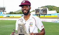 Roston Chase with the Wisden Trophy after the series win.