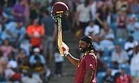 Chris Gayle celebrates a record half century off just 19 balls