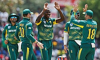 South Africa's Kagiso Rabada (C) celebrates with Faf du Plessis (18) , David Miller (10), Tabraiz Shamsi (L) and Aiden Markram (2nd R)