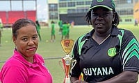 Erva Giddings receiving her Player of the Match award from CWI's Josina Luke