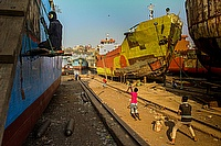 Dockyard workers' children – some of whom also work on the boats – play cricket near the Buriganga River.