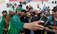 Pakistan's Shoaib Malik poses for a selfie with fans