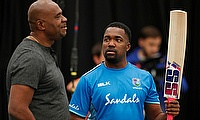 West Indies' Darren Bravo talks with Ian Bishop during nets
