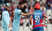 Mark Wood consoles Afghanistan's Hashmatullah Shahidi, who was hit in the head from a bowl