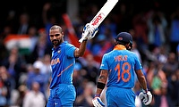 India's Shikhar Dhawan celebrates his century with Virat Kohli