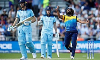Lasith Malinga celebrates taking the wicket of England's Jos Buttler