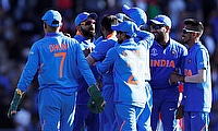 India's Mohammed Shami celebrates taking the wicket of Afghanistan's Mujeeb Ur Rahman with team mates to complete a hat trick and win