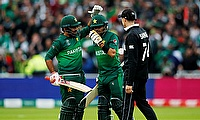 Pakistan's Babar Azam and Sarfaraz Ahmed celebrate after winning the match