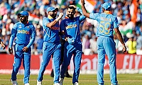 India's Virat Kohli celebrates with team mates