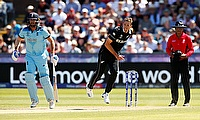 New Zealand's Tim Southee in action as England's Liam Plunkett looks on