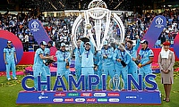 England's Eoin Morgan and teammates celebrate winning the World Cup with the trophy