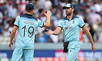 England's Chris Woakes shakes hands with Liam Plunkett after England's innings