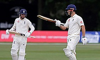 Sam Hain celebrates his 50 against the Australian XI at Canterbury