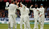 England's Stuart Broad celebrates with team mates after taking the wicket of Ireland's Andy McBrine