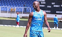 Kemar Roach walks back to his mark during the net session
