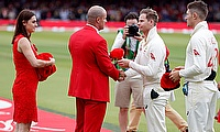 Australia's Steve Smith hands over a cap to Andrew Strauss before the match in support of the Ruth Strauss Foundation