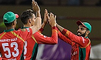Shadab Khan (R) of Guyana Amazon Warriors celebrates