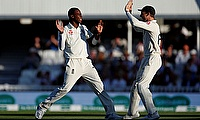 Jofra Archer celebrates with teammate Jos Buttler