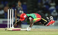 Carlos Brathwaite of St Kitts and Nevis Patriots dives in to make his ground