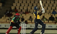 Andre Fletcher of St Lucia Zouks hits four as Devon Thomas of St Kitts and Nevis Patriots looks on