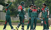 Bangladesh players celebrate a wicket