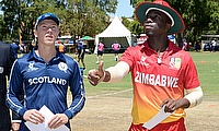 Angus Guy of Scotland, Match Referee, Graeme Labrooy and Dion Myres of Zimbabwe