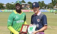 Sylvester Okpe of Nigeria and Marcus Thurgate of Japan during the ICC U19 Cricket World Cup 15th Place Play-Off match between Nigeria and Japan