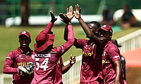 Jayden Seales of West Indies celebrates taking the wicket of Bryce Parsons of South Africa